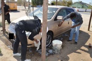 United Soul members washing a car.