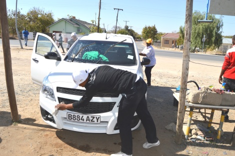 Francistown United Souls members busy at the Rainbow Explosion Car Wash.